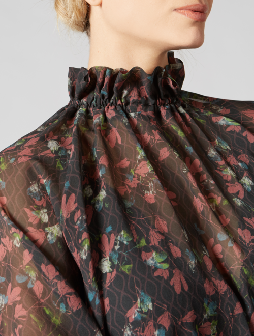 Ruffled silk georgette turtleneck blouse